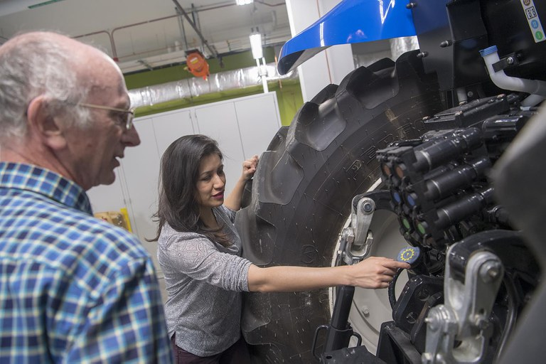 Penn State student and professor examining an off-road vehicle.
