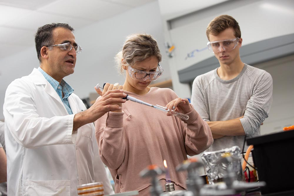 Penn State students testing water in the lab
