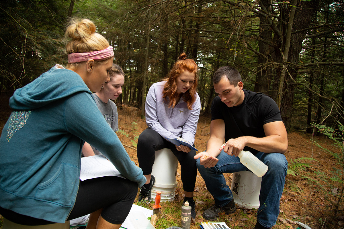 Environmental Soil Science students determining soil texture and type.