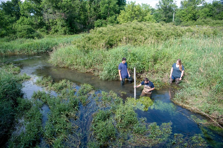 Penn State students measuring stream depth.