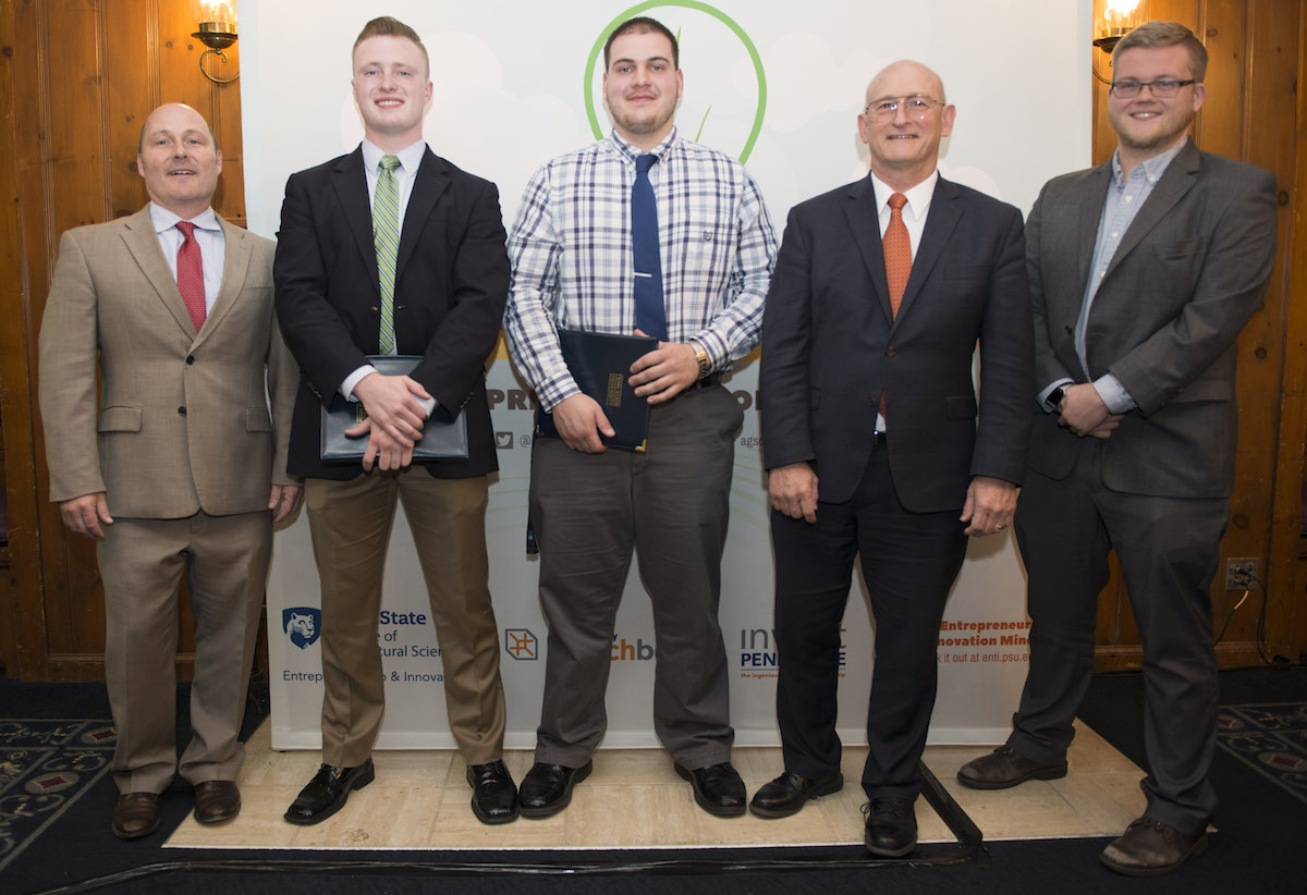 won $2,500 and second place Thursday April 13 in the Ag Springboard student business pitch contest. L to R: Mark Gagnon, Entrepreneurship Coordinator, College of Agricultural Sciences, CAS students Sam Collins (agribusiness management major), Curtis Hershey (animal science major), CAS Dean Richard Roush, and Luke Yost (material science major). (Photo by Cameron Hart)