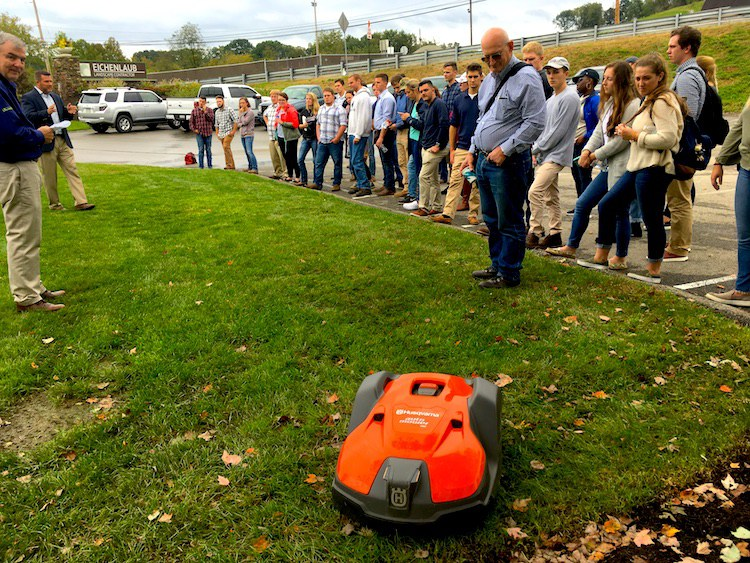 Agribusiness management students get an up-close look at autonomous lawn mowers on a visit to Eichenlaub, Inc., an upscale landscape services firm in Pittsburgh. Students are helping Eichenlaub evaluate the mowers. (Photo by Angela Barr)