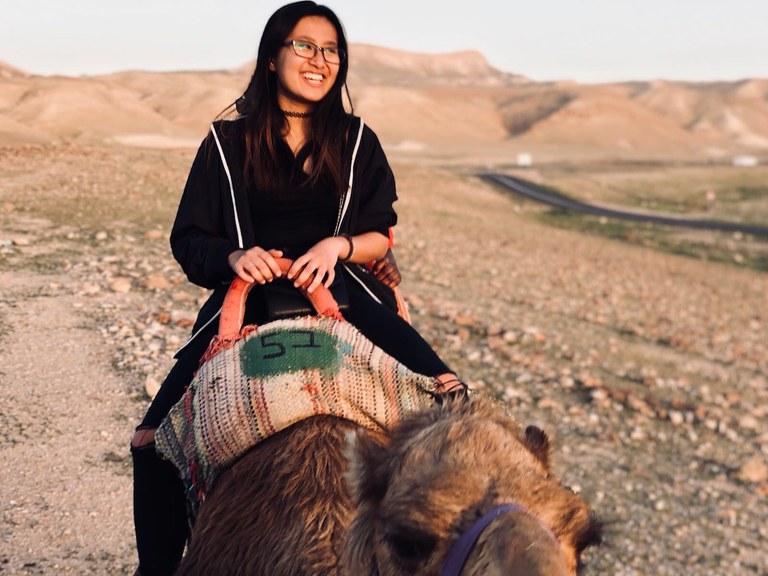 Tran (Tresca) Ngo riding a camel. Image by Benjamin Cutler.