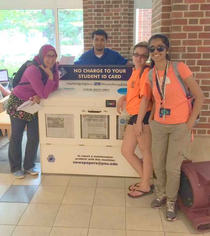 Graduate students Roshan Nayak and Nur Wahid on a global learning resources scavenger hunt with PGSAS participants
