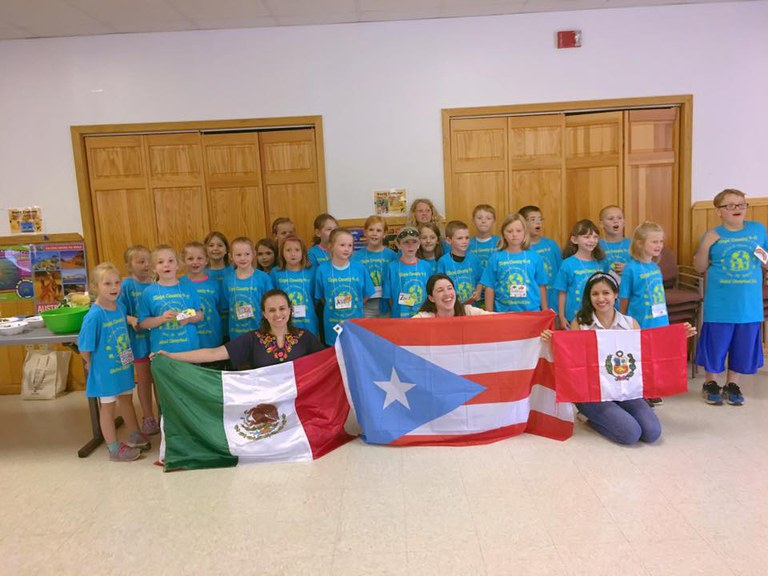 4-H kids in Tioga County with (left to right) Ilse (Mexico), Laura (Puerto Rico) and Mara (Peru) holding our flags