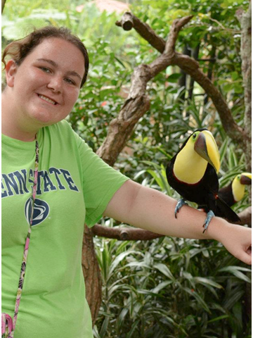 Samantha holding a native species of bird, the toucan