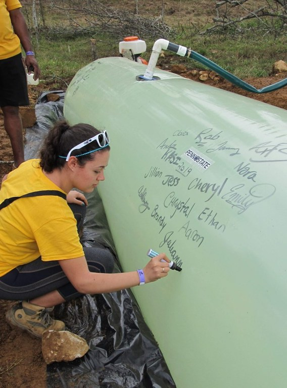 Signing our names on the biodigester we built for a local farmer.