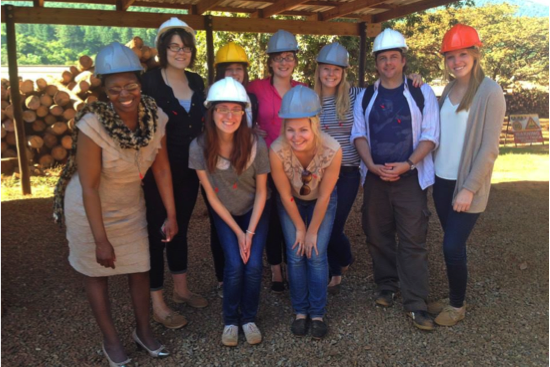 The group getting a tour of occupational health practices at a sawmill.