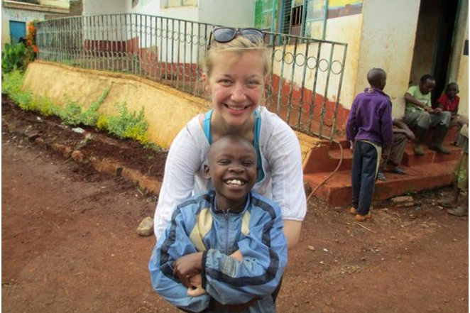 Arianna with a local child at the Children and Youth Empowerment Center (CYEC), Kenya