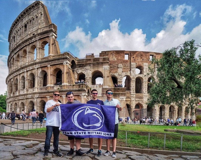 In front of the Colosseum on our first day in Italy