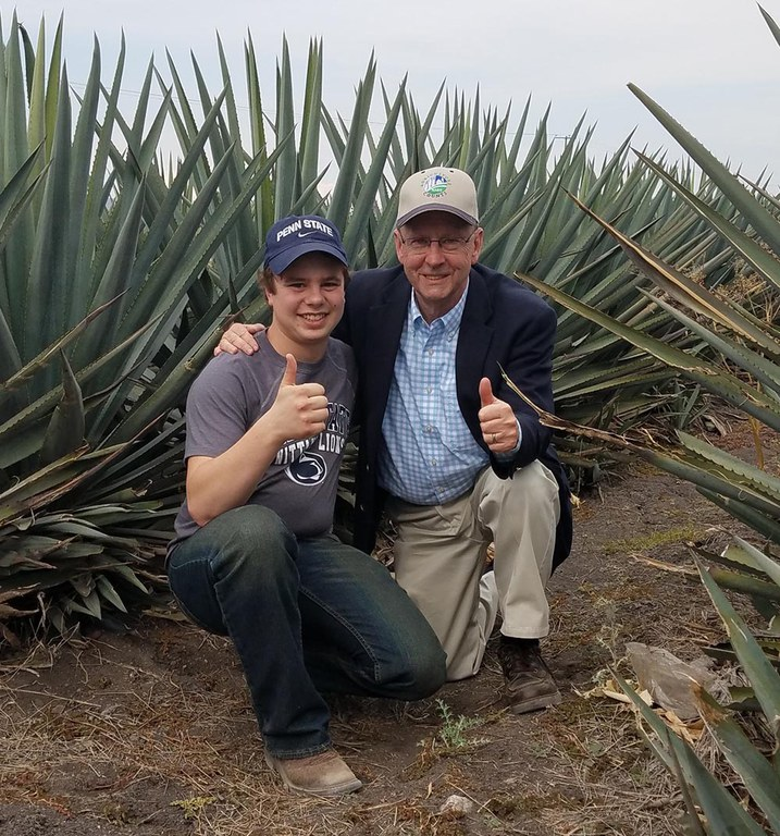Secretary Hayes and I in the agave fields.