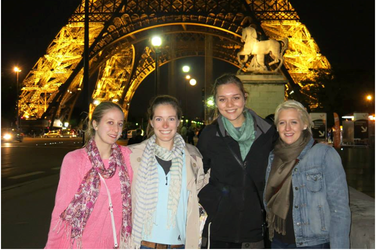 Standing under the sparkling Eiffel Tower on our last night together in Paris