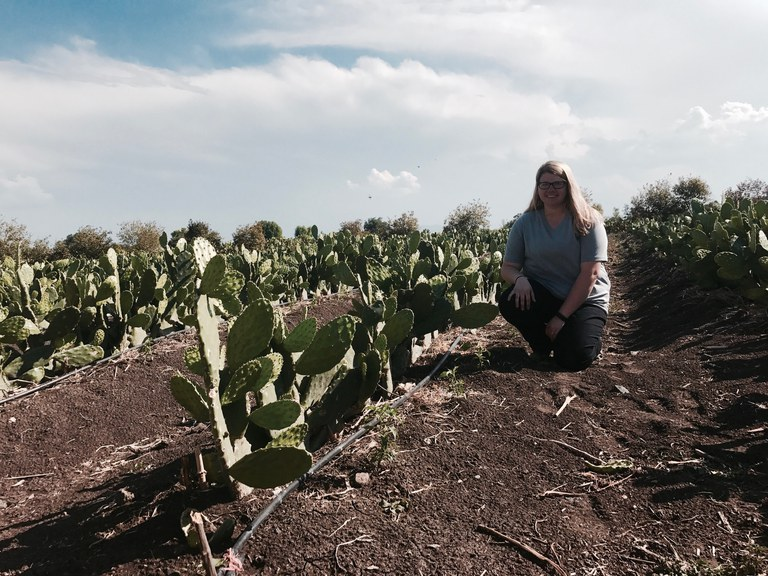 Myself posing with cacti at the cactus farm we visited!