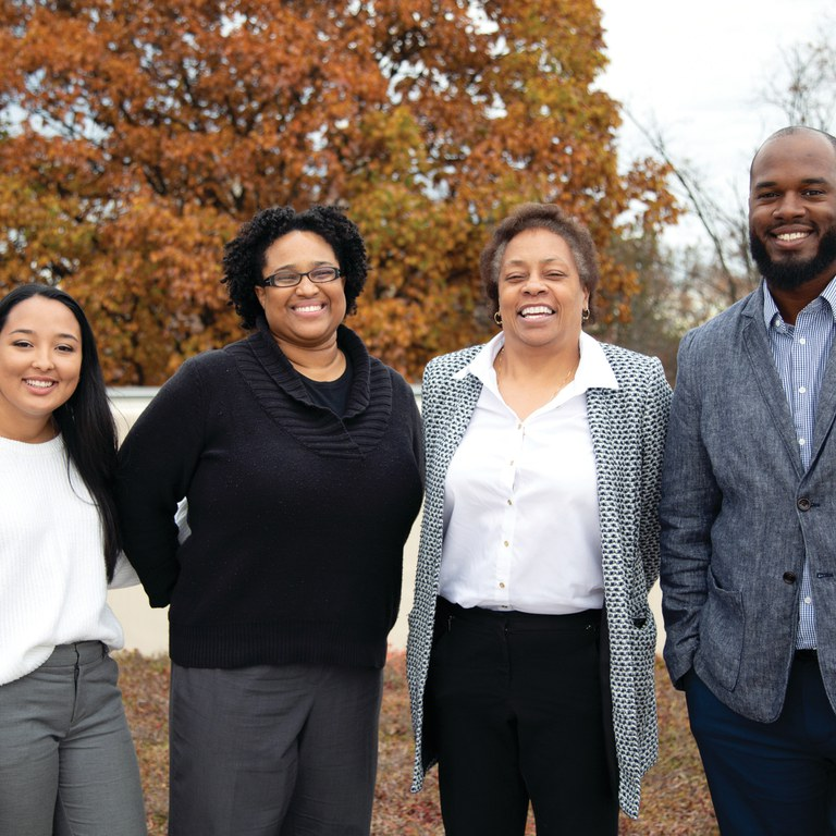 Alumni who engaged with faculty, students, and staff during a November visit were, from left, Manoelle DaSilva, Shakira Nelson, Tina Terrell, and Ian Stringer.