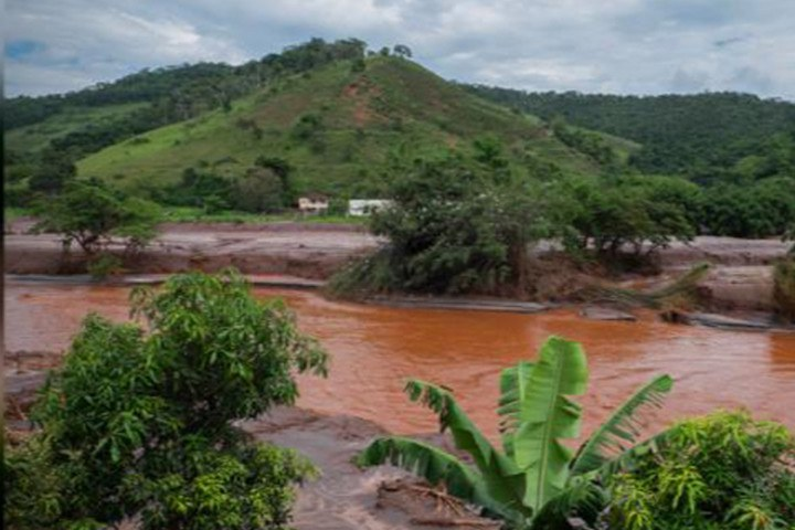 The Mariana Dam disaster in 2015 released more than 11 billion gallons of iron ore waste. The huge wave of toxic mud flowed into the Doce River (shown here) basin surrounding Mariana City in Minas Gerais, a state in southeast Brazil. Photo: Erika Ganda