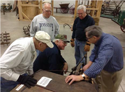 Volunteers discuss regular maintenance schedules and checklists to put in place for large artifact maintenance.
