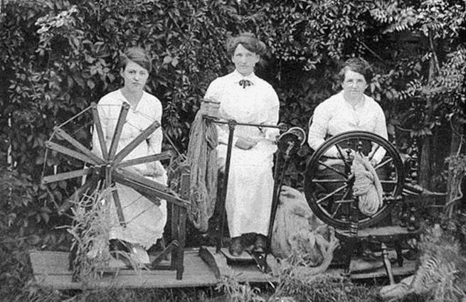 Three women spinning wool to knit socks for soldiers during World War I - Tenterfield, NSW, ca. 1915