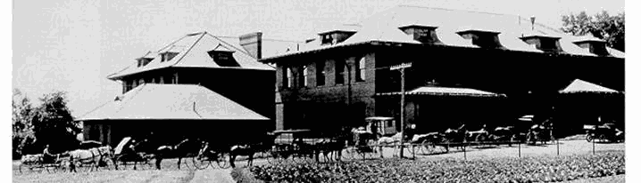 Farmers line up to deliver milk to the College creamery (later Patterson Building). The creamery sold most of its products in the State College and Altoona retail markets.