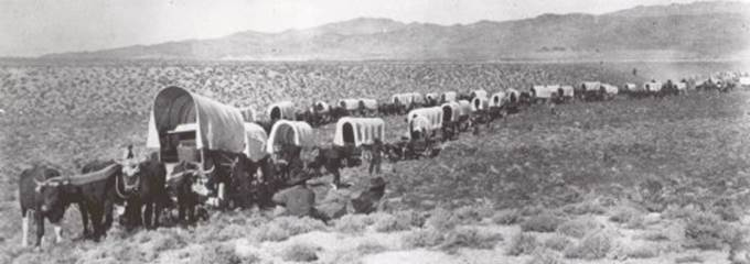 Thousands of pioneers traveled through the City of Rocks on their way to Oregon and California.  This National Park Service photo shows one wagon train on the road leading up to the granite spires.