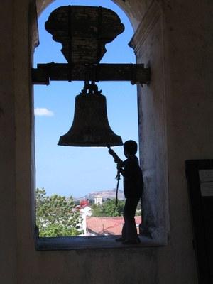 Boy ringing bell in Nicaraguan church