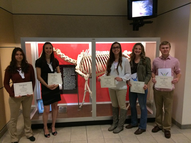 New members of Coaly Society in front of Coaly's Bones in the HUB-Robeson Center.