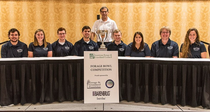 The Penn State 2018 American Forage Bowl team includes, from left, Glenn Travis, Casey Baxter, Jonathan Stephens, Zachary Curtis, Cullen Dixon, Taylor O'Guinn, Ben Crusan and Sunnie Liggett. Standing is Marvin Hall, professor of forage management.